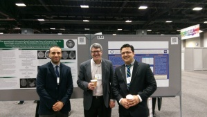 Senior residents Drs. Mahmoud Abdelrazek (left) and Haris Kamal (right) with Dr. Gil Wolfe, Prof. and Chair of Neurology, at AAN Poster Session